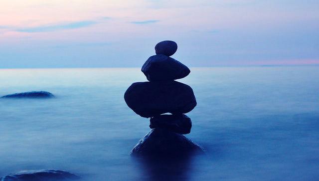 stacked rocks in ocean