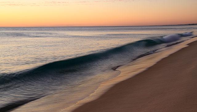 waves on shore at sunrise