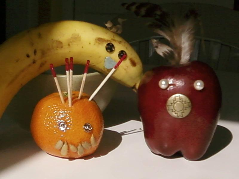 apple, orange, and banana with button faces