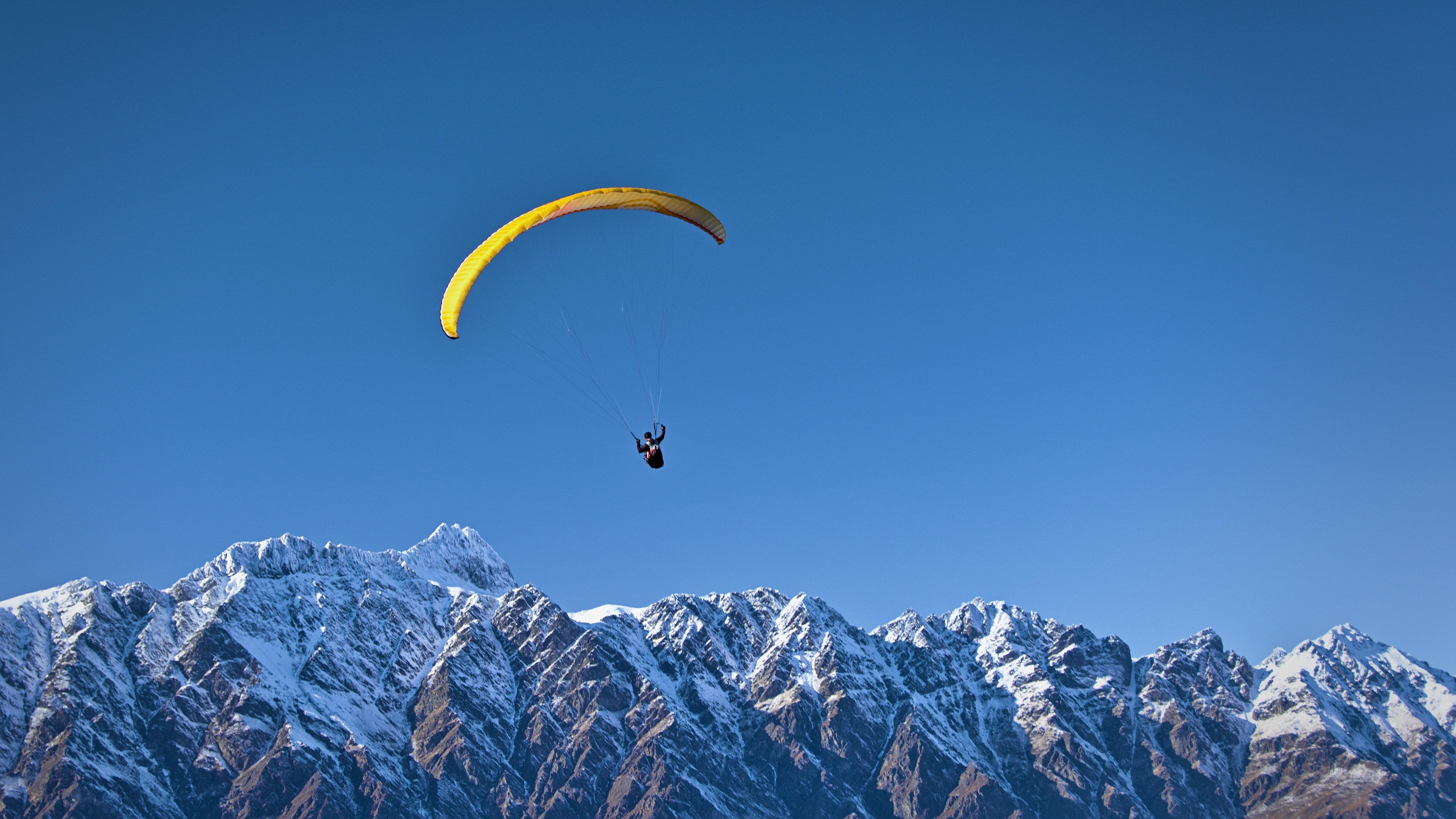 paragliding over mountain range