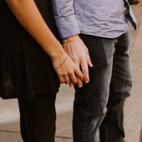 couple touching hands