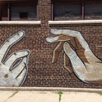 graffiti of reaching hands