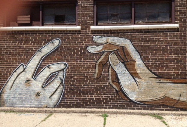 graffiti of reaching hands