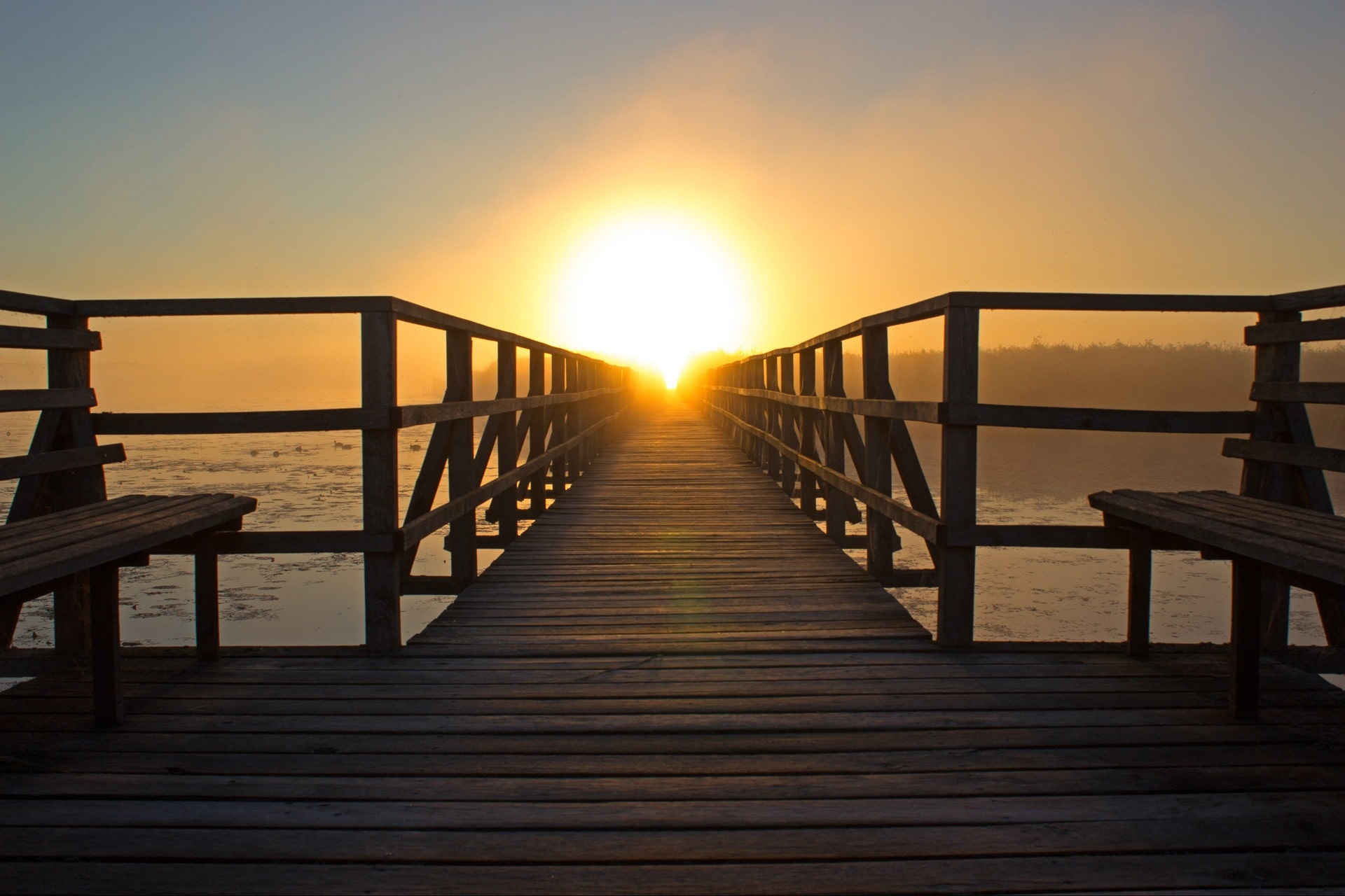 sunrise at the end of a dock