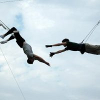 two people on trapeze