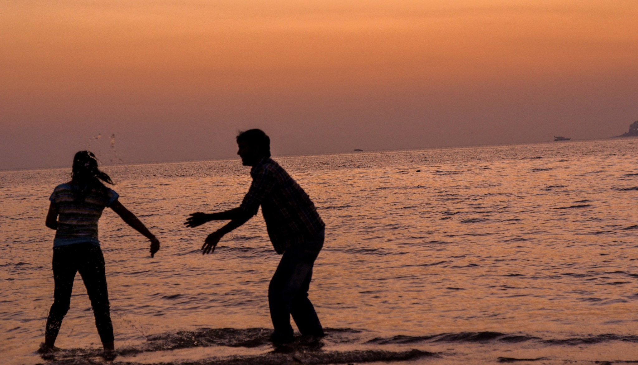two people playing in water