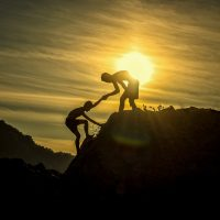 boys climbing mountain