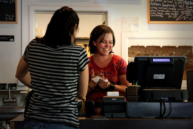 Woman smiling serving customer