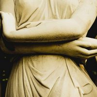 statues holding hands in solidarity, sex worker support