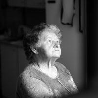elderly woman in sunlight