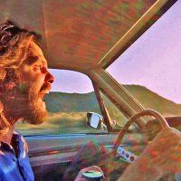 man screaming while driving