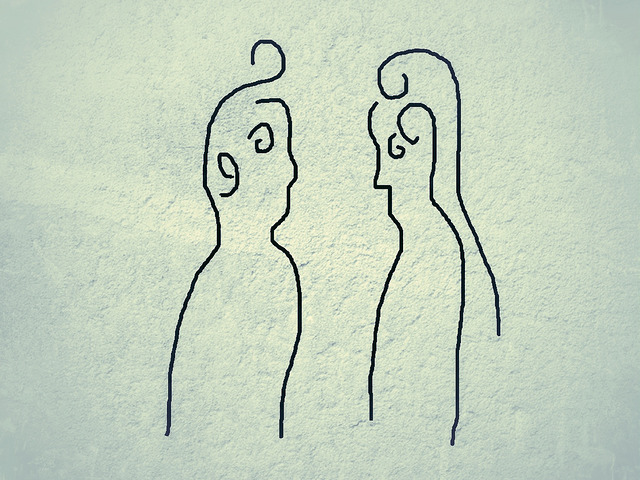 sketched figures facing one another