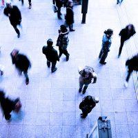 people walking through train station