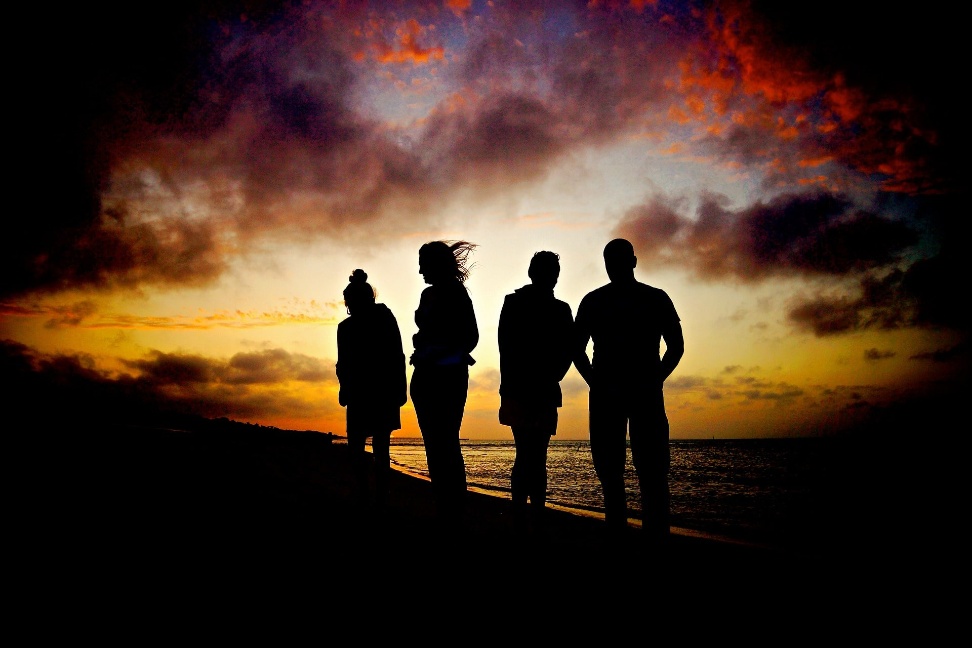 group overlooking sea at sunset